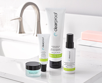 Clear Proof® Acne System in while, green and black tubes on a bathroom counter with the teal, transparent Indulge® Soothing Eye Gel