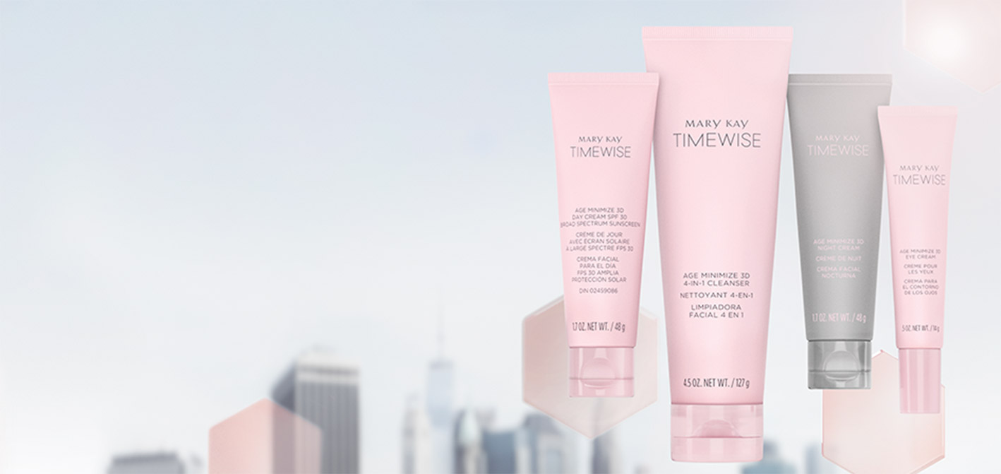 Mary Kay's new TimeWise Miracle Set 3D skin care regimen floats in front of pink translucent hexagons on an image of a city skyline.