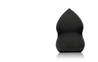 Shop now for the NEW Blending Sponge from Mary Kay. Helps to create a seamless and even application of makeup. Makes a great gift! A black blending sponge is displayed in the right corner.