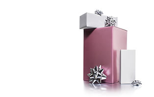 Go to MyMK to see or share Mary Kay products that you or people you know want as gifts. Image features three gift boxes of various size with the largest one being pink with silver bows.