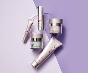 The TimeWise Repair skin care regimen in purple and gray tubes and jars on a purple background